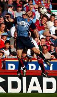 Photo. Richard Lane<br />Aton Villa v Arsenal. Barclaycard Premiership. 05/04/2003.<br />Rob Edwards (rt) challenges Freddie Ljungberg for the ball.