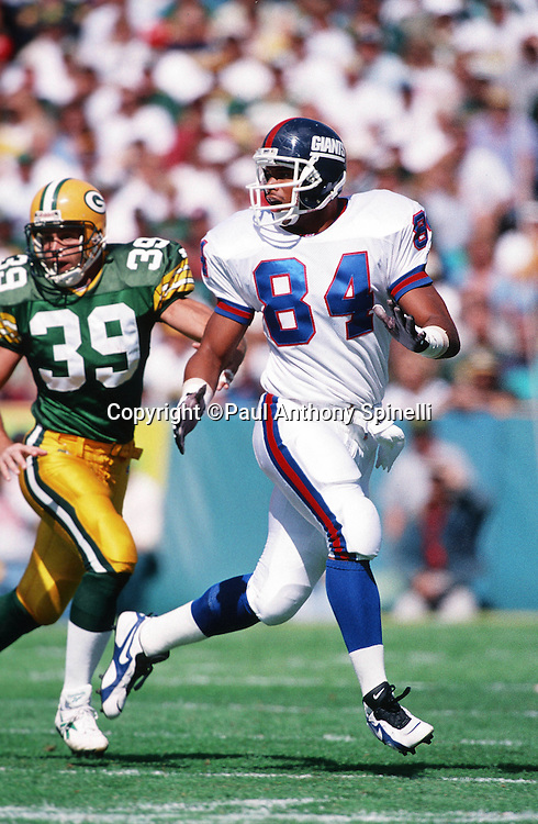 New York Giants tight end Aaron Pierce (84) goes out for a pass while covered by Green Bay Packers cornerback Mike Prior (39) during the NFL football game against the Green Bay Packers on Sept. 17, 1995 in Green Bay, Wis. The Packers won the game 14-6. (©Paul Anthony Spinelli)