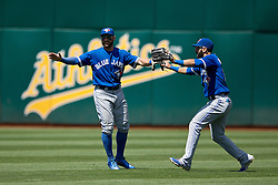 OAKLAND, CA - JULY 23:  Kevin Pillar #11 of the Toronto Blue Jays and Jose Bautista #19 celebrate after the game against the Oakland Athletics at O.co Coliseum on July 23, 2015 in Oakland, California. The Toronto Blue Jays defeated the Oakland Athletics 5-2. (Photo by Jason O. Watson/Getty Images) *** Local Caption *** Kevin Pillar; Jose Bautista