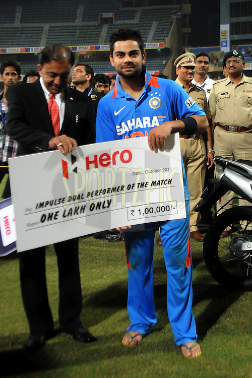 Virat Kohli of India receives the HERO Impulse dual performer award during the 4th One Day International ( ODI ) match between India and England held at the Wankhede Stadium, Mumbai on the 23rd October 2011..Photo by Pal Pillai/BCCI/SPORTZPICS
