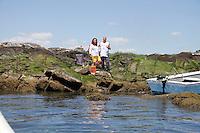 Alex Schibli with his wife Noelva Vigoya visit his island - Rat Island for a picnic on June 15, 2012