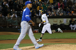 OAKLAND, CA - JULY 15:  Khris Davis #2 of the Oakland Athletics rounds the bases after hitting a two run home run off of Marcus Stroman #6 of the Toronto Blue Jays during the fifth inning at the Oakland Coliseum on July 15, 2016 in Oakland, California. (Photo by Jason O. Watson/Getty Images) *** Local Caption *** Khris Davis; Marcus Stroman