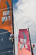 Bowmen from Sanya (left) and Camper (right) up the mast searching for a breeze during the ProAm races in Miami at Volvo Ocean Race 2011-2012.