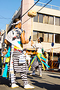 Men performing in the Tenjin Festival (Tenjin Matsuri) in Osaka.