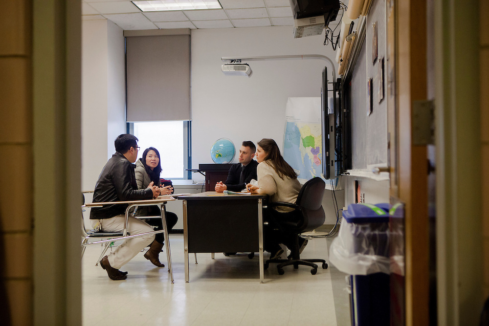 NEW YORK, NY - MARCH 27, 2015: Parents speak with student teacher Bradford Snyder and teacher Josina Dunkel during parent-teacher conferences at Stuyvesant High School. Each parent unit is allotted three minute with each teacher.
