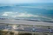 Nederland, Zuid-Holland, Rotterdam, 10-06-2015; Tweede Maasvlakte (MV2), Maasvlaktestrand met parkeerterreinen en duinovergangen die toegang geven tot het badstrand.<br /> Second Maasvlakte, Maasvlakte Beach with parking and dune crossings that provide access to the bathing beach.<br /> luchtfoto (toeslag op standard tarieven);<br /> aerial photo (additional fee required);<br /> copyright foto/photo Siebe Swart