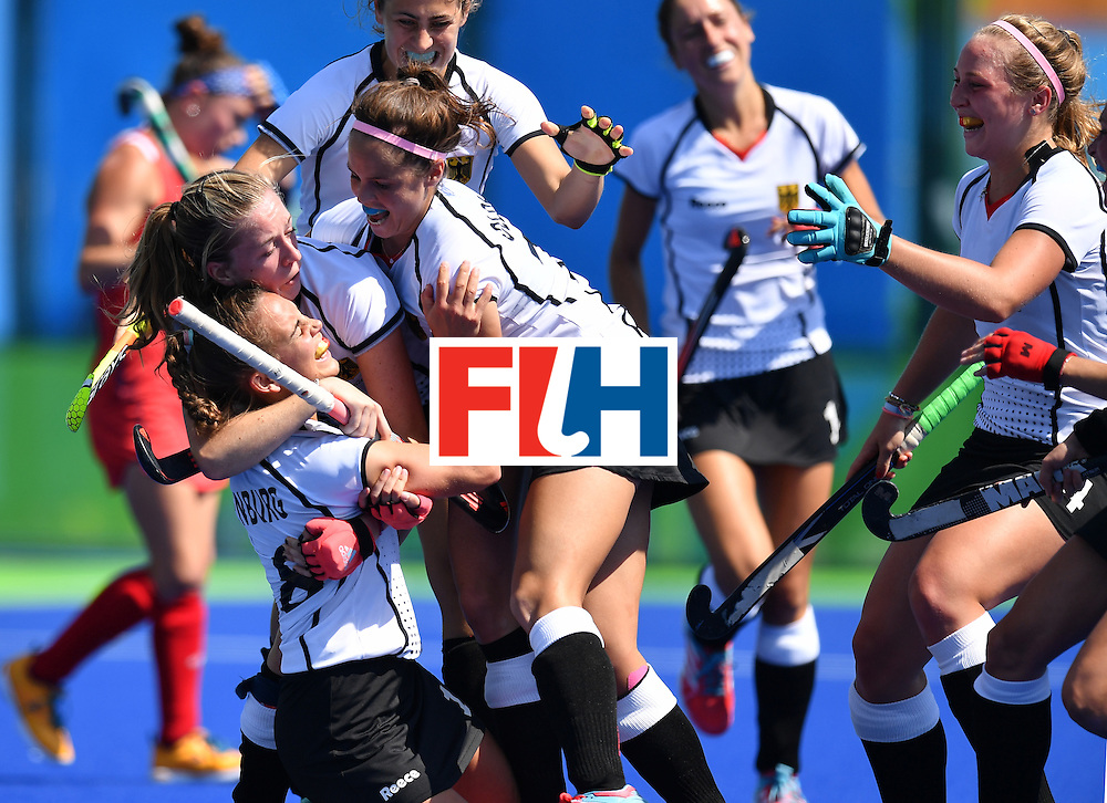 Germany's Lisa Altenburg (L bottom) celebrates a goal with teammates during the women's quarterfinal field hockey USA vs Germany match of the Rio 2016 Olympics Games at the Olympic Hockey Centre in Rio de Janeiro on August 15, 2016. / AFP / MANAN VATSYAYANA        (Photo credit should read MANAN VATSYAYANA/AFP/Getty Images)