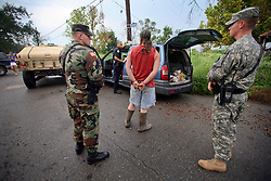 24 August 2006 - New Orleans - Louisiana. <br /> Lower 9th ward. Military police and NOPD officers apprehend and hold two suspects for looting abandoned houses. The witness who had reported the men taking items from houses could no longer be located and the men were released without charge.<br /> Photo Credit. Charlie Varley/varleypix.com