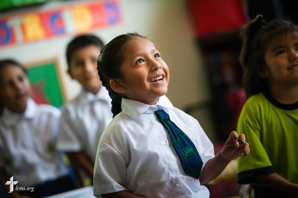 A young student listens as the Rev. Herb Burch, LCMS career missionary to Peru (not pictured), entertains the class with a song about Jesus at the Noe school, one of many places affected by recent landslides near Lima, Peru, on Tuesday, April 7, 2015.  LCMS Communications/Erik M. Lunsford