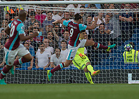 Football - 2016/2017 Premier League - Chelsea V West Ham United. <br /> <br /> Thibaut Courtois of Chelsea clears in front of an on rushing Andy Carroll of West Ham at Stamford Bridge.<br /> <br /> COLORSPORT/DANIEL BEARHAM