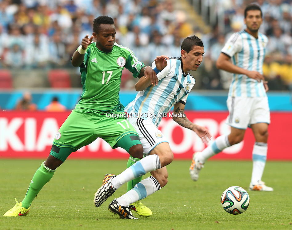 Fifa Soccer World Cup - Brazil 2014 - <br /> NIGERIA  (NGA) Vs. ARGENTINA (ARG) - Group F - Estadio Beira-RioPorto Alegre - Brazil (BRA) - June 25, 2014 <br /> Here Nigerian player Ogenyi ONAZI (L) and Argentine player Angel Di Maria (R)<br /> &copy; PikoPress