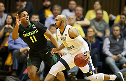 Jan 9, 2018; Morgantown, WV, USA; West Virginia Mountaineers guard Jevon Carter (2) drives towards the basket during the first half against the Baylor Bears at WVU Coliseum. Mandatory Credit: Ben Queen-USA TODAY Sports
