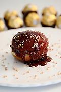 Sufganiyah (Sufganyot) a traditional Jewish Doughnut eaten during Hanukkah with Ferrero Rocher chocolate