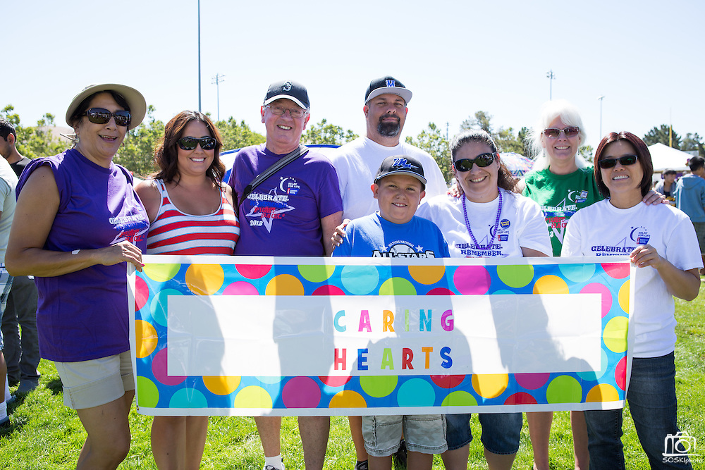 Caring Hearts pose for a photo during Relay For Life at the Milpitas Sports Center in Milpitas, California, on June 22, 2013. (Stan Olszewski/SOSKIphoto)