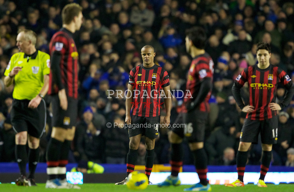 LIVERPOOL, ENGLAND - Tuesday, January 31, 2012: Manchester City's captain Vincent Kompany looks dejected after Everton's first goal during the Premiership match at Goodison Park. (Pic by Vegard Grott/Propaganda)