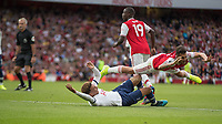Football - 2019 / 2020 Premier League - Arsenal vs. Tottenham Hotspur<br /> <br /> In an incident missed by VAR and the referee Dani Ceballos (Arsenal FC) goes flying over the top of Dele Alli (Tottenham FC) as they wait for the game to restart at The Emirates.<br /> <br /> COLORSPORT/DANIEL BEARHAM