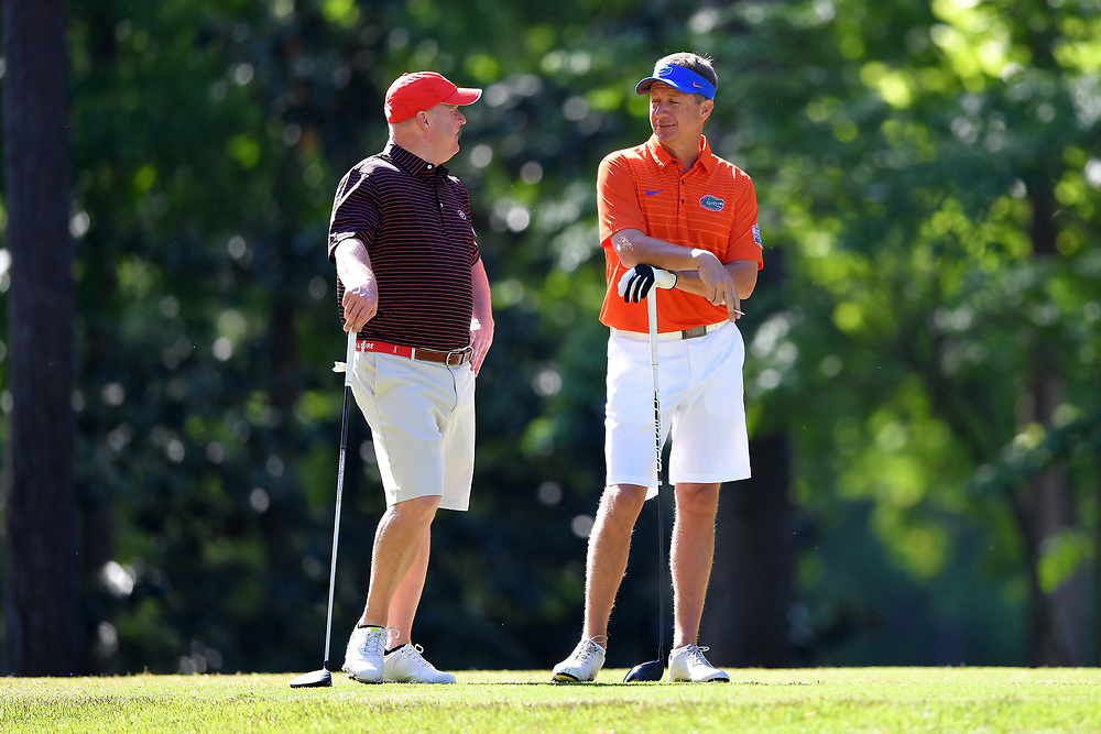 David Dukes talks to Judd Davis during the Chick-fil-A Peach Bowl Challenge at the Oconee Golf Course at Reynolds Plantation, Sunday, May 1, 2018, in Greensboro, Georgia. (Dale Zanine via Abell Images for Chick-fil-A Peach Bowl Challenge)