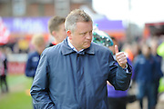 Northampton Town manager Chris Wilder gives a thumbs up before the Sky Bet League 2 match between Exeter City and Northampton Town at St James' Park, Exeter, England on 16 April 2016. Photo by Graham Hunt.
