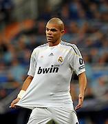 Pepe tugs at his shirt as Real Madrid take on AC Milan in Madrid, Spain, 21-10-2009