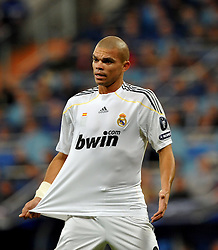 Pepe tugs at his shirt as Real Madrid take on AC Milan in Madrid, Spain, 21-10-2009