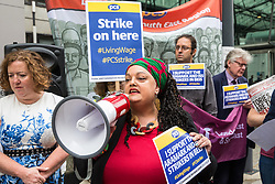 London, UK. 15 July, 2019. Zita Holbourne, National Vice-President of the PCS trade union addresses catering and cleaning staff outsourced to work at the Department for Business, Energy and Industrial Strategy (BEIS) via contractors ISS World and Aramark on the picket line outside the Government department after walking out on an indefinite strike for the London Living Wage, terms and conditions comparable to the civil servants they work alongside and an end to outsourcing.