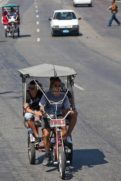 Tricycle is a popular way to get around in Havana.