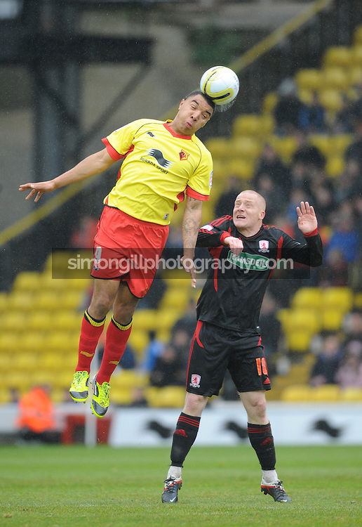 28.04.2012 Watford, England. Watford v Middlesbrough. Troy Deeney (Striker) in action against Nicky Bailey (Middlesbrough) Midfielder during the NPower Championship game played at Vicarage Road.