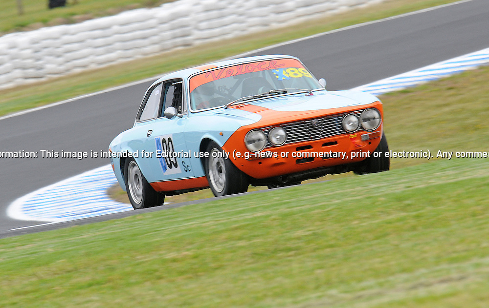 David Harris - Alfa Romeo 105 GTV.Historic Motorsport Racing - Phillip Island Classic.18th March 2011.Phillip Island Racetrack, Phillip Island, Victoria.(C) Joel Strickland Photographics.Use information: This image is intended for Editorial use only (e.g. news or commentary, print or electronic). Any commercial or promotional use requires additional clearance.