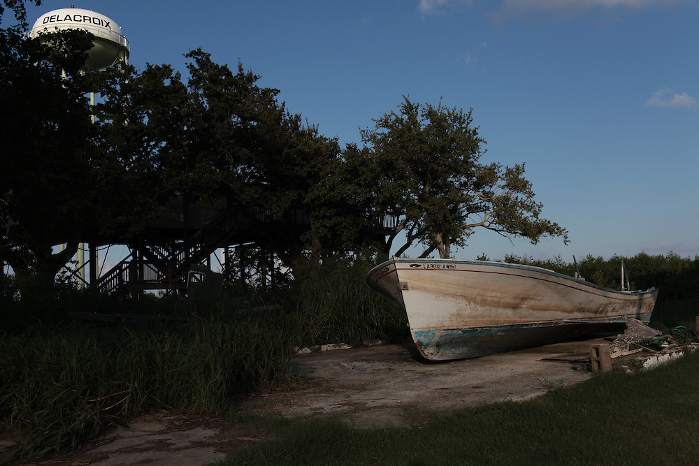 An old boat sits on an empty lot on Delacroix Island, LA on September 01, 2010. Hurricane Katrina devastated the small island community, then came the BP oil spill that took another toll on the fishing community.