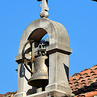 St. Peter of Cetinje Bell in Kotor, Montenegro<br /> This humble silver bell with a double-crossed crucifix above its yoke is dated 2006. This is extremely new relative to the Medieval and Renaissance period churches in Kotor. It belongs to the Church of Saint Peter of Cetinje which is almost invisible except for a small flight of stairs. Their denomination is Montenegrin Orthodox, a small religious community founded in Montenegro in 1993 and recognized by the government in 1999. They believe they own all the property of the Serbian Orthodox Church in this country such as the neighboring St. Nicholas Church. But to date, their claims have not been substantiated nor have they been canonized.