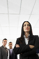Businesswoman with two businessmen portrait low angle view