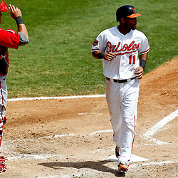 March 24, 2012; Sarasota, FL, USA; Baltimore Orioles second baseman Robert Andino (11) scores on a base loaded walk during the bottom of the fourth inning of a spring training game against the Washington Nationals at Ed Smith Stadium.  Mandatory Credit: Derick E. Hingle-US PRESSWIRE