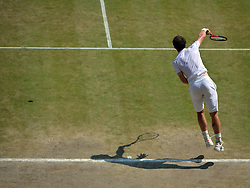 © London News Pictures. 07/07/2013 . London, UK. Andy Murray in action during the men's singles final against Novak Djokovic of Serbia at the Wimbledon Lawn Tennis Championships final. Andy Murray won the match  becoming the first British male to win the tournament in 77 years. Photo credit: Mike King/LNP