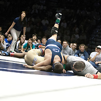February 23, 2014; State College, PA, USA; Penn State's Nico Megaludis scores a near fall on Clarion's Hunter Jones to end their 125-pound match at Rec Hall. Megaludis notched a 21-5 technical fall win and Penn State defeated Clarion 43-3.