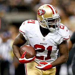 Nov 17, 2013; New Orleans, LA, USA; San Francisco 49ers running back Frank Gore (21) against the New Orleans Saints during the first quarter of a game at Mercedes-Benz Superdome. Mandatory Credit: Derick E. Hingle-USA TODAY Sports