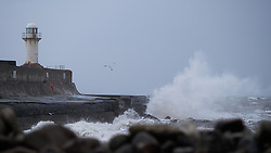 © Licensed to London News Pictures. <br /> 01/02/2015. <br /> <br /> South Gare, Redcar, United Kingdom<br /> <br /> Huge waves crash against the sea wall and lighthouse at South Gare near Redcar in Teesside.<br /> <br /> Photo credit : Ian Forsyth/LNP