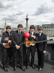Actors Emanuelle Angeletti, Reuvon Gershon , Stephen Hill  and Gordon Elsemore at the launch of the new West End Beatles musical Let It Be on the rooftop of a London hotel, Thursday, 23rd August 2012.   Photo by: i-Images