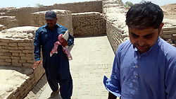 April 29, 2017 - Pakistan - MOHENJO DARO, PAKISTAN, APR 29: Labours busy in construction work to save the World .Heritage Site from monsoon rains under the supervision of Culture and Tourism Department in .Mohenjo Daro on Saturday, April 29, 2017. (Credit Image: © PPI via ZUMA Wire)