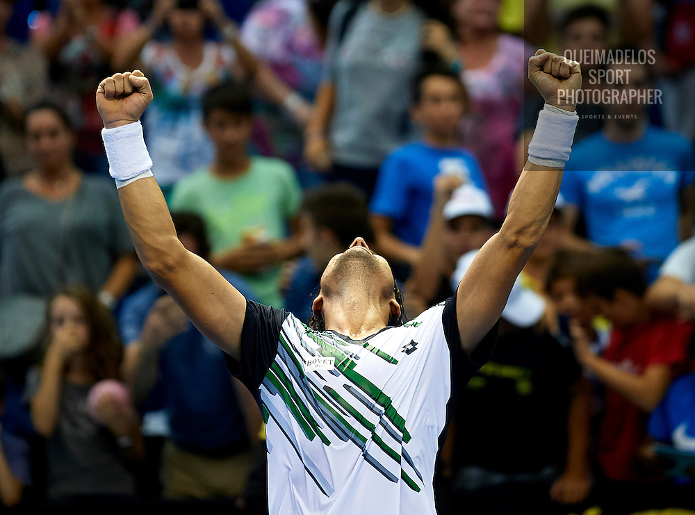 VALENCIA, SPAIN - OCTOBER 24:  David Ferrer of Spain celebrates defeating Thomaz Bellucci of Brazil during day five of the ATP 500 World Tour Valencia Open tennis tournament at the Ciudad de las Artes y las Ciencias on October 24, 2014 in Valencia, Spain.  (Photo by Manuel Queimadelos Alonso/Getty Images)