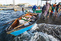 Subsistence Fishers rowing boat on the slipway at the harbour, Struisbaai Harbour, Struisbaai, Western Cape, South Africa