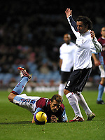 Photo: Dave Linney.<br />Aston Villa v Bolton Wanderers. The Barclays Premiership. 16/12/2006. Villa's Stiliyan Petrov(L) is sent flying by   Ivan Campo.