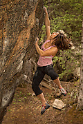 Professional boulderer Alex Puccio bouldering in the Rocky Mountains of Colorado