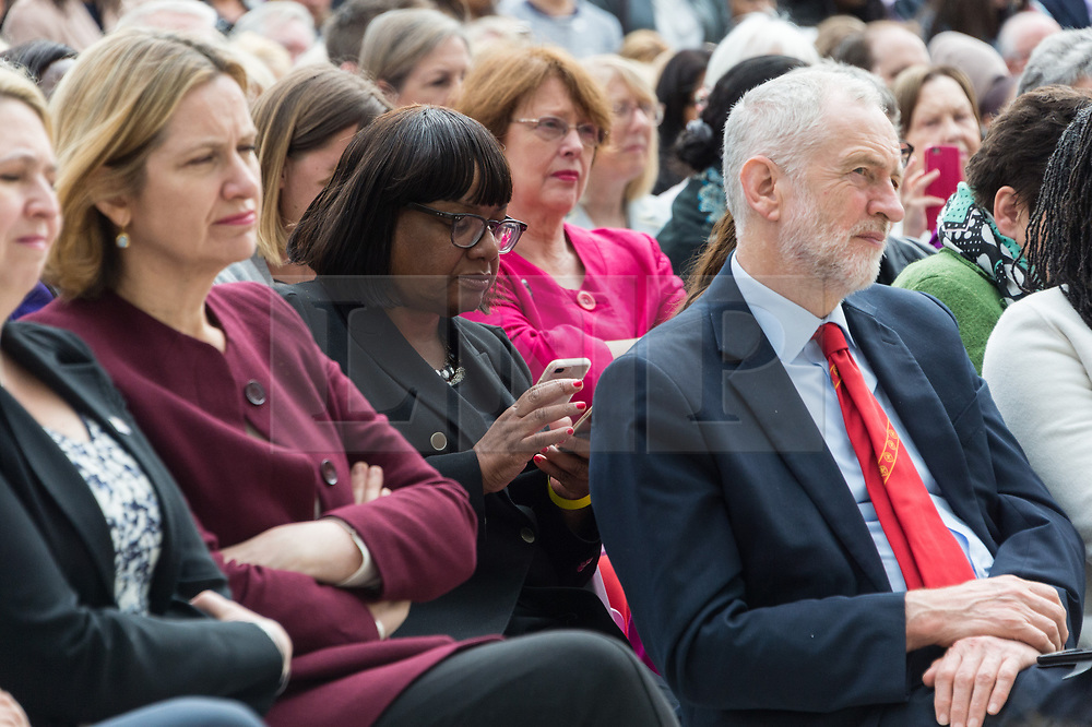 © Licensed to London News Pictures. 24/04/2018. London, UK. © Licensed to London News Pictures. 24/04/2018. London, UK. DIANE ABBOTT MP uses her mobile phone during British Prime Minister THERESA MAY speech at the statue unveiling of the Suffragist leader Millicent Fawcett in Parliament Square. The Mayor of London commissioned Turner prize-winning artist GILLIAN WEARING OBE to create the statue. Photo credit: Ray Tang/LNP