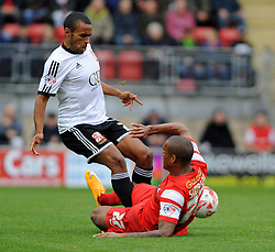 Leyton Orient's Jay Simpson tackles Swindon Town's Nathan Thompson - photo mandatory by-line David Purday JMP- Tel: Mobile 07966 386802 - 04/10/14 - Leyton Orient  v Swindon Town - SPORT - FOOTBALL - Sky Bet Leauge 1  - London -  Matchroom Stadium