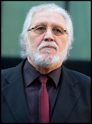 Former Radio one DJ Dave Lee Travis arrives  at Southwark Crown Court. London, United Kingdom. with his wife Marianne, Monday, 24th February 2014. Picture by Andrew Parsons / i-Images