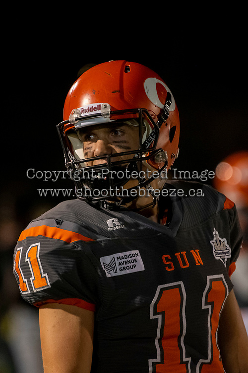 KELOWNA, BC - AUGUST 3:  Adam Burton #11 of Okanagan Sun stands on the sidelines against the Kamloops Broncos  at the Apple Bowl on August 3, 2019 in Kelowna, Canada. (Photo by Marissa Baecker/Shoot the Breeze)