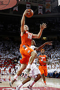 FAYETTEVILLE, AR - NOVEMBER 30:  Brandon Triche #20 of the Syracuse Orangemen goes up for a lay up against the Arkansas Razorbacks at Bud Walton Arena on November 30, 2012 in Fayetteville, Arkansas.  The Orangemen defeated the Razorbacks 91-82.  (Photo by Wesley Hitt/Getty Images) *** Local Caption *** Brandon Triche