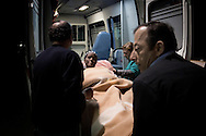 ITALY. Lampedusa:A pregnant ethiopian woman is carried in hospital after her arrival in Lampedusa on March 26, 2011. Copyright Christian Minelli.
