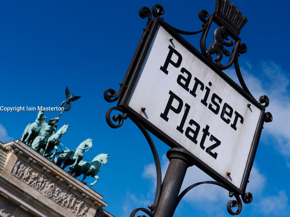 Pariser Platz sign and Quadriga on Brandenburg Gate in Berlin