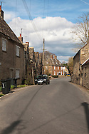 View along The Street looking towards The Red Lion pub in the Cotswold village of Castle Eaton on the Thames Path, Wiltshire, Uk